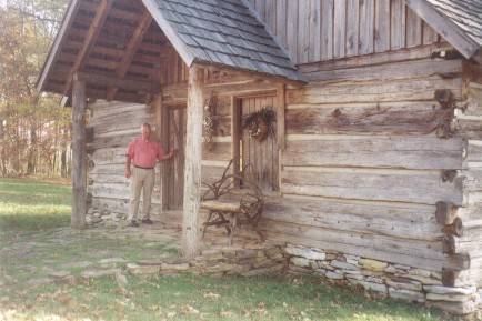 Submitted by Linda Higgins: Here's my husband, Richard Higgins standing at the front door of the reconstructed Little Flat Creek